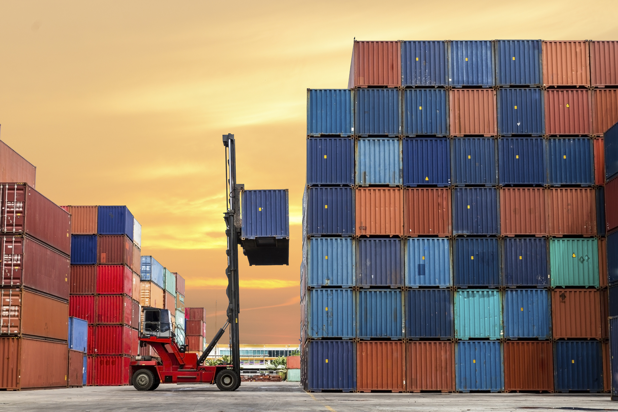 Crane-lifting-up-container-in-yard-486570435_2125x1416