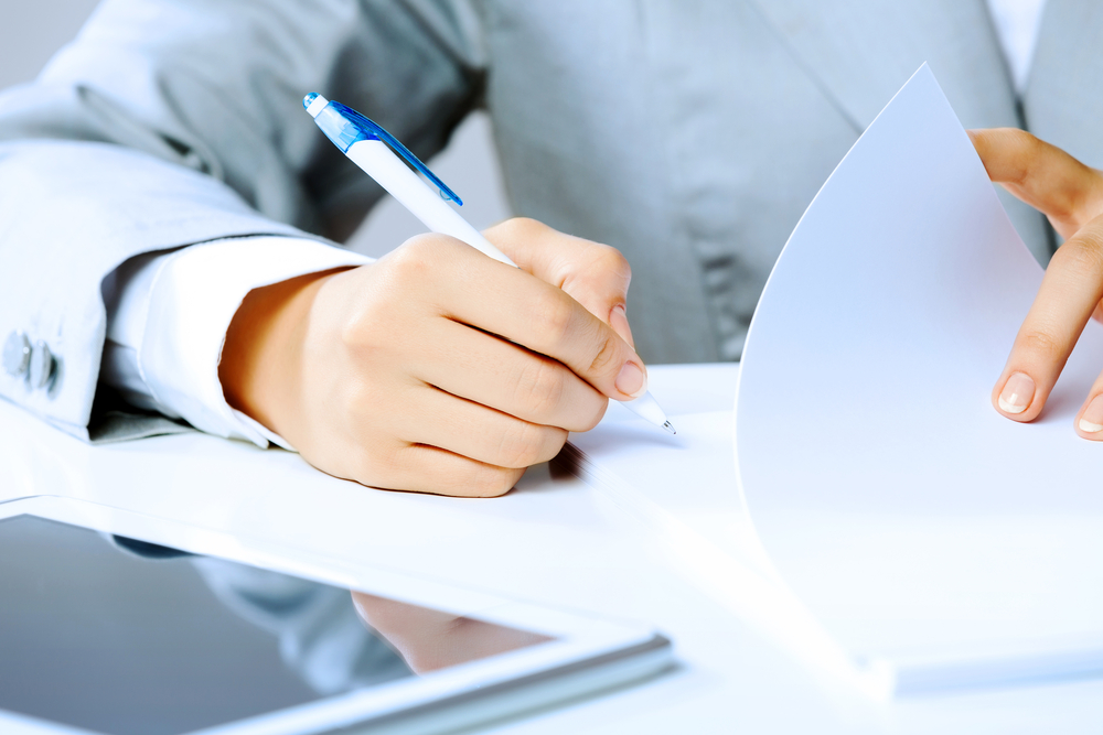 Close up image of businesswoman hands signing documents-1