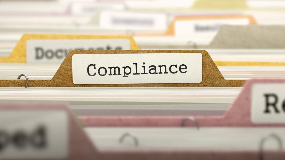 Compliance Concept on Folder Register in Multicolor Card Index. Closeup View. Selective Focus.